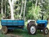 ටැක්ටරය ටේලරය සහ බවුසරය සමග  Tractor