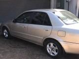 Mazda mazda familia 323 2003 Car